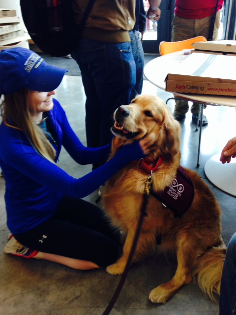 photo of student petting a dog