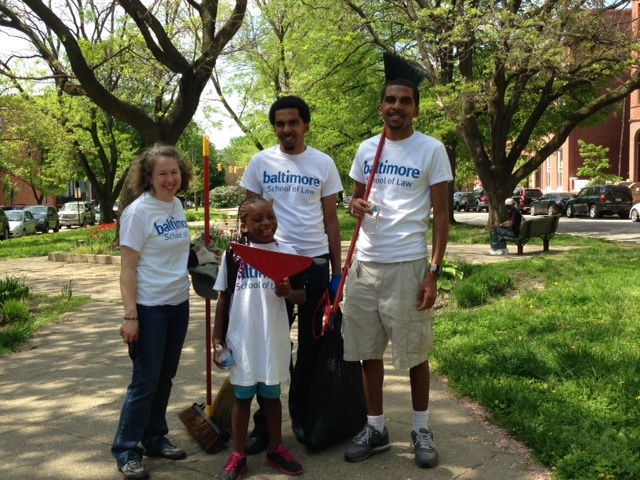 Helping clean up were (from left) Dean Vicki Schultz, Calvin Young, 2L Caylin Young and 7-year-old Amaiya Collins.