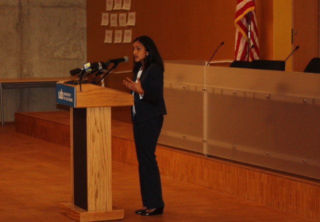 Vanita Gupta, head of the U.S. Department of Justice's Civil Rights Division, talks to Baltimore residents  about the department's investigation of  Baltimore's police department.