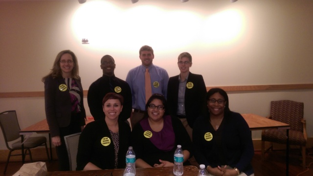 "Pictured in the front row (from left) are Professor Jessica Emerson and student-attorneys  Melissa DeLeon and Tiffany Alston. In the back row are Professor Michele Gilman and student-attorneys Bryan Upshur, Garrett Hasslinger and Meredith Boram. Their buttons say, ""I stand for second chances."""