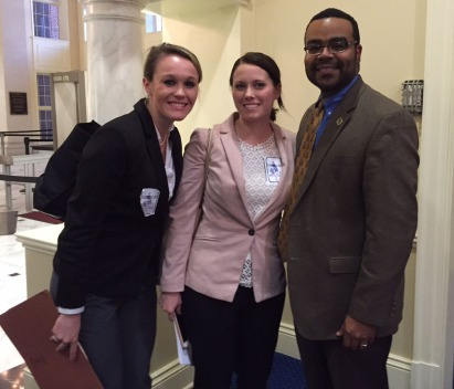 Bronfein Family Law Clinic student-attorneys Madison Kyger (left) and Taylor LoSchiavo (center) with Del. Charles Sydnor III.