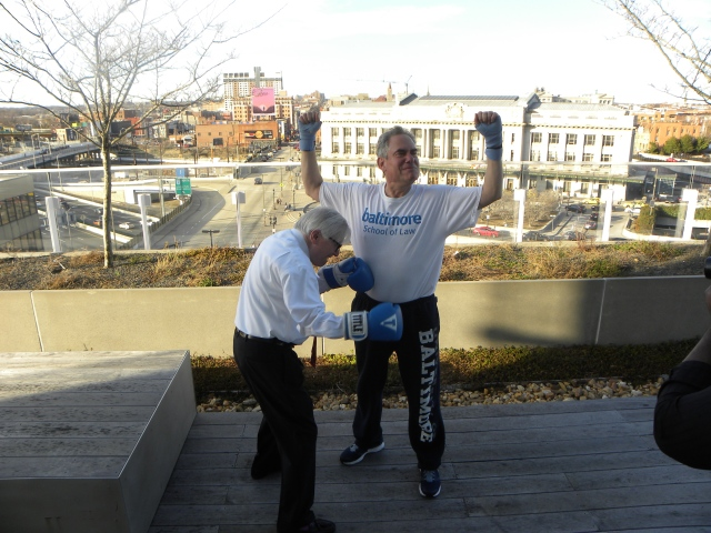 Professor Byron Warnken works to get Dean Weich in shape for the March 28