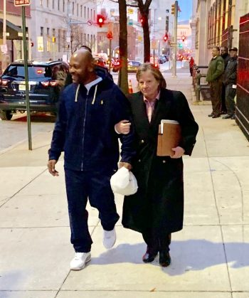 Recently exonerated of a crime he did not commit, Clarence Shipley Jr. leaves the courthouse a free man, accompanied by his attorney, Michele Nethercott, of the University of Baltimore School of Law.