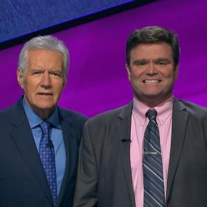 Eric Backes with Jeopardy! host Alex Trebek