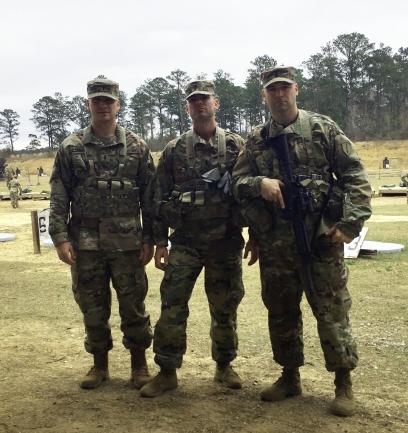 three alumni in Army JAG corps