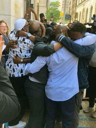 Exonerees greet their family after their release.
