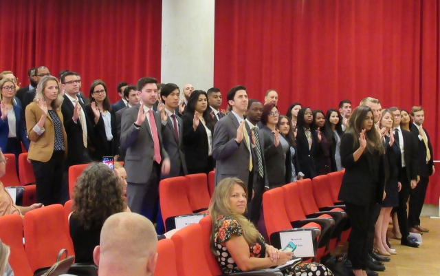 Student-attorneys take the oath.