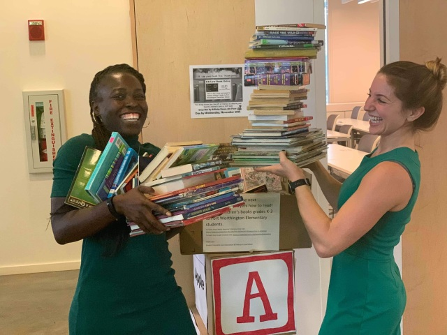 Magdala Norton, left, and Jessica Blumberg with some of the children's books they have collected.